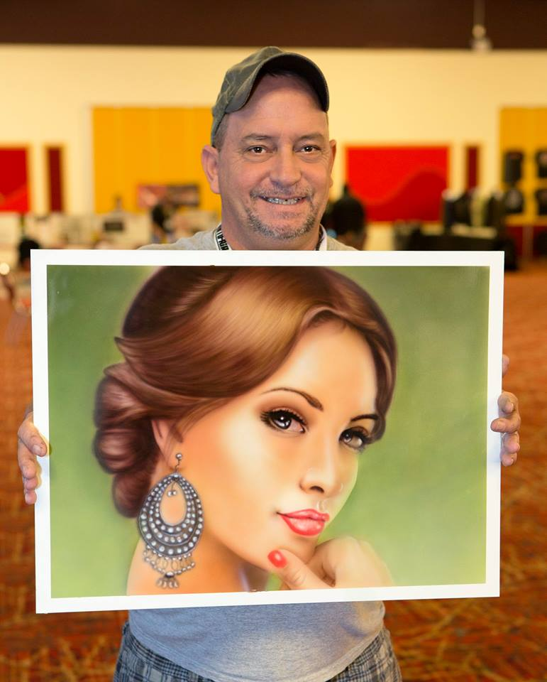 Richard Dipple proudly shows off his finished portrait. POWER PORTRAITS class.